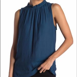 Teal blue ruffled neck top